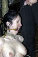 pissing on bondage girl slave forced mouth ropes piercing urine domination